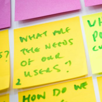 """Post it with """"what are the needs of our users"""" written on it"""