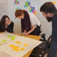team looking at chart
